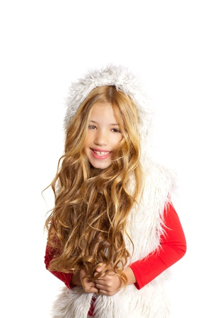 Kid little girl with christmas winter white fur and red shirt photo