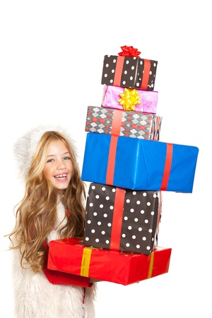 girl with christmas present gifts stacked on white background photo
