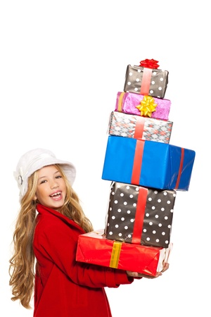 kid girl holding many gifts stacked on her hand isolated on white photo