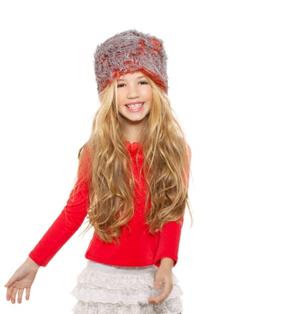 kid girl winter dancing with red shirt and fur hat on white background photo