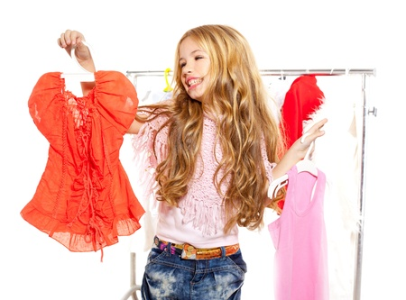 victims: fashion victim kid girl at backstage wardrobe choosing clothes