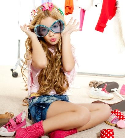 child model: fashion victim kid girl wardrobe messy playing with sunglasses