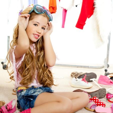 fashion victim kid girl wardrobe messy playing with sunglasses Stock Photo - 12148217