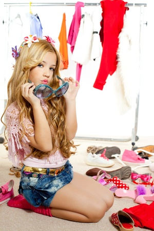 shoes fashion: fashion victim kid girl wardrobe messy playing with sunglasses