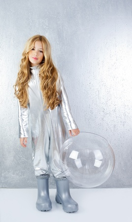 futuristic girl: Astronaut futuristic kid girl with silver full length uniform and glass bubble helmet