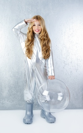 shiny suit: Astronaut futuristic kid girl with silver full length uniform and glass bubble helmet