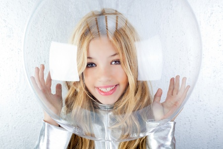 shiny suit: Astronaut futuristic kid girl with silver uniform and glass helmet