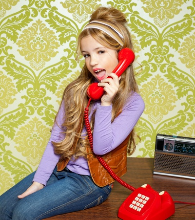 kid girl retro hip vintage talking busybody with red telephone photo