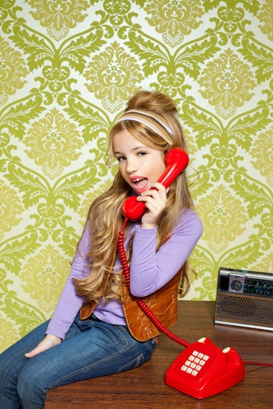kid girl retro hip vintage talking busybody with red telephone Stock Photo - 12148402