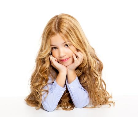 pretty little girl: blond kid little student girl portrait smiling on a desk in white background