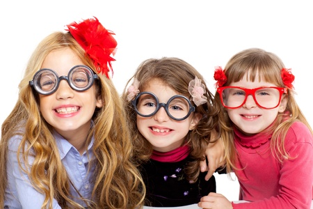 nerd children girl group with glasses and funny expression photo