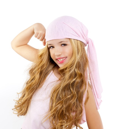 female muscle: kid girl with pirate handkerchief showing her biceps muscle