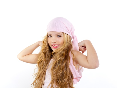 kid girl with pirate handkerchief showing her biceps muscle photo