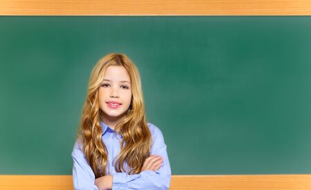 kid student girl on green blackboard posing with smile photo