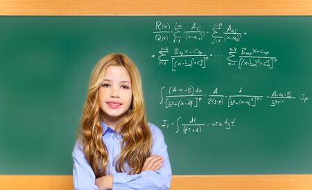 kid smart student girl with difficult math formula on green school blackboard photo