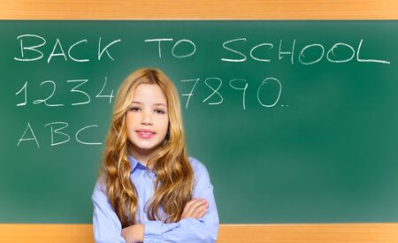 kid student girl on green school blackboard with witten back to school text photo