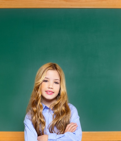 kid student girl on green blackboard posing with smile Stock Photo - 12148215