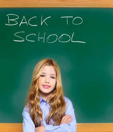 kid student girl on green school blackboard with written back to school text Stock Photo - 12148202
