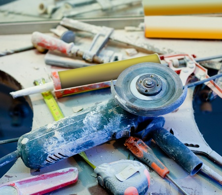 home improvement repair messy clutter with dusted tools handtools Stock Photo - 12382930