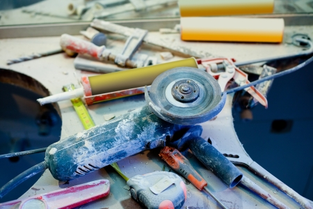clutter: home improvement repair messy clutter with dusted tools handtools