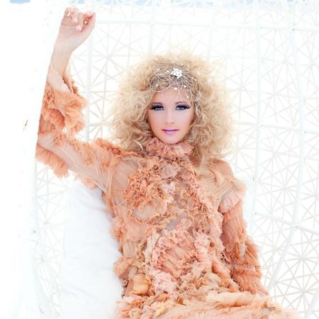 haute: Baroque haute couture woman portrait with vampire inspiration in hammock Stock Photo