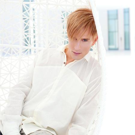 blond modern man portrait in summer terrace vampire inspiration photo