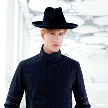 black far west modern fashion man with hat in modern indoor photo
