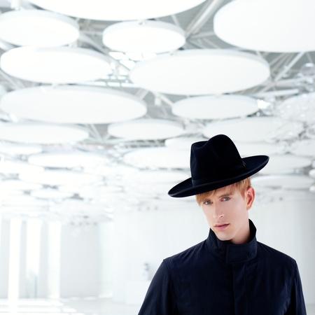 black far west modern fashion man with hat in modern indoor Stock Photo - 12382394