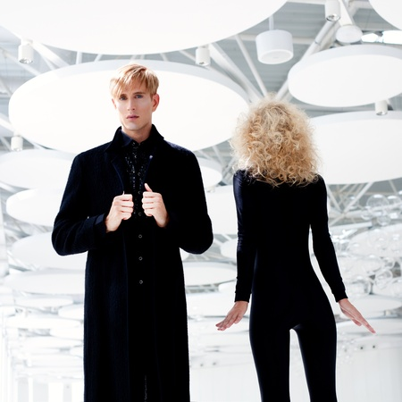 haute: Blond couple classic movie secret agent and sexy girl in black