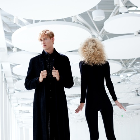 futuristic man: Blond couple classic movie secret agent and sexy girl in black