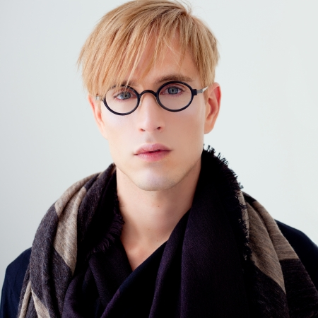 haute couture: blond modern handsome student man with nerd glasses portrait