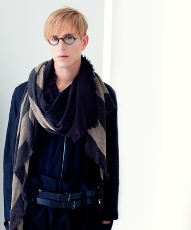 blond modern handsome student man with nerd glasses portrait photo