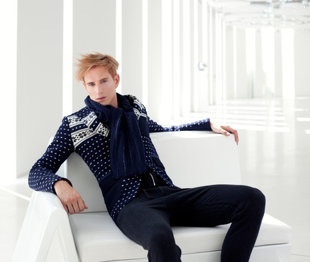 modern blond male futuristic sci-fi sitting in white indoor photo