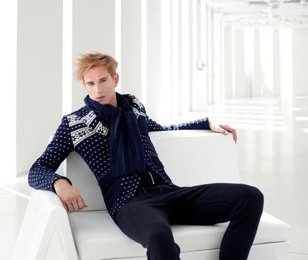 modern blond male futuristic sci-fi sitting in white indoor photo