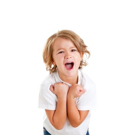 ni�os rubios: los ni�os emocionados chico con la expresi�n feliz ganador aislado en blanco Foto de archivo