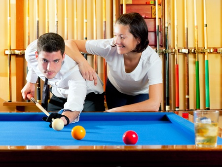 cue sports: couple playing billiard expertise teacher and beautiful girl