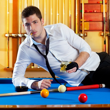 manly: Billiard handsome player man drinking some alcohol in club Stock Photo