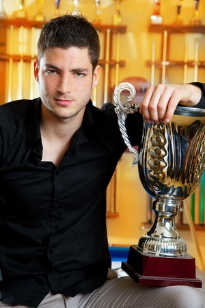 Happy proud winner man with big trophy silver cup in billiard club Stock Photo - 13123834