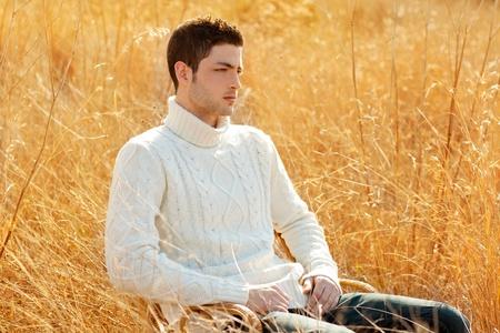 turtleneck: Autumn winter man portrait in outdoor dried grass field with turtleneck sweater