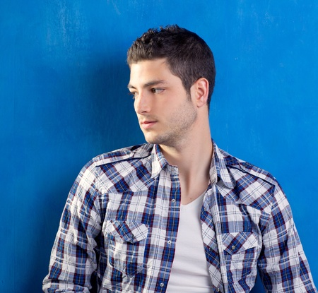 handsome young man with plaid shirt on blue background Stock Photo - 13123549