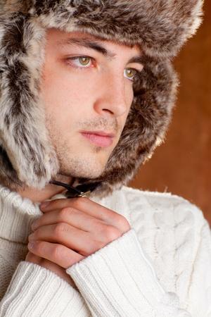 autumn winter man with brown fur  hat portrait photo