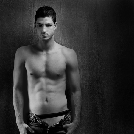 manly man: Black and white sexy young denim shirtless man on retro grunge background