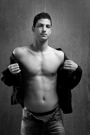 Handsome sexy young shirtless man denim in black and white photo