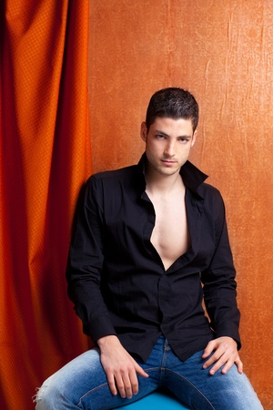 open shirt: Latin spanish man portrait open black shirt with curtain and orange vintage background