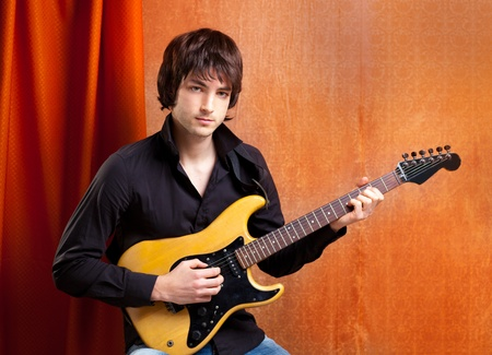 sexy guitar: british indie pop rock look young musician guitar player man