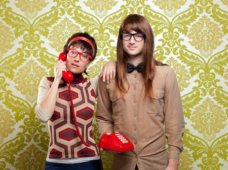 funny nerd humor couple talking retro vintage red telephone on wallpaper Stock Photo - 13123846