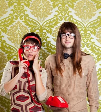 funny nerd humor couple talking retro vintage red telephone on wallpaper photo
