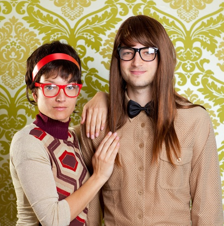 geek: Funny humor silly nerd couple on retro vintage wallpaper background
