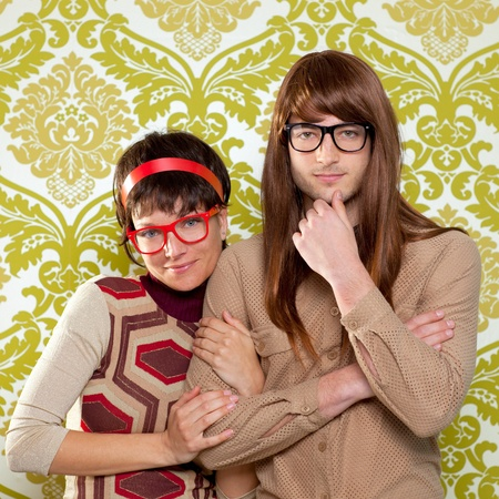 70s adult: Funny humor silly nerd couple on retro vintage wallpaper background
