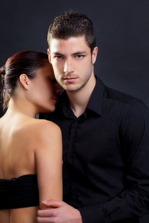 embraces: Couple in love with handsome man and rear profile woman nude back